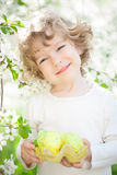 Child holding Easter eggs Royalty Free Stock Photos