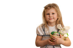 Child is holding Easter rabbit and painted eggs Stock Photography