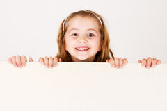 Child holding empty board Stock Image