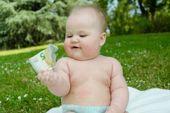 Child holding a 5 euro. Bill Stock Image