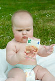 Child holding 10 euros. Child holding a bill of 10 euros Royalty Free Stock Images