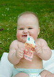 Child holding 10 euros. Child holding a bill of 10 euros Royalty Free Stock Photography