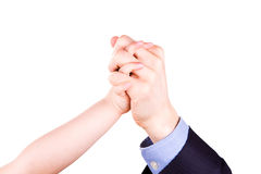 Child holding father's hand. Trust, togethterness and support concept. Child holding father's hand isolated on white. Trust, togethterness and support concept Royalty Free Stock Photography