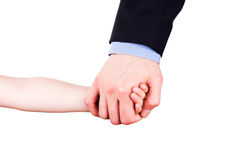 Child holding father's hand. Trust, togethterness and support concept. Child holding father's hand isolated on white. Trust, togethterness and support concept Royalty Free Stock Images
