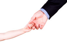 Child holding father's hand. Trust, togethterness and support concept. Stock Photos