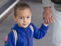 Child holding father's hand Royalty Free Stock Images