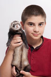 Child holding ferret Stock Image