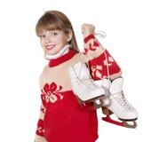 Child holding figure skates. Stock Photo