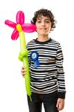 Child holding a flower balloon during his birthday party over a white background Royalty Free Stock Image