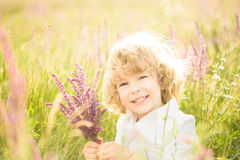 Child holding flowers Royalty Free Stock Photography