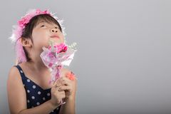 Child Holding Flowers Background. Girl with Flowers Background Stock Photo