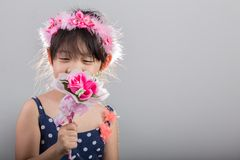 Child Holding Flowers Background. Girl with Flowers Background Royalty Free Stock Images