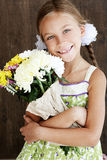 Child holding flowers Stock Images