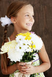 Child holding flowers Royalty Free Stock Images