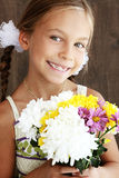 Child holding flowers Royalty Free Stock Image