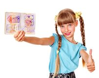 Child holding  foreign passport. Stock Photos
