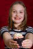 Child holding a fresh baked cupcake Stock Image