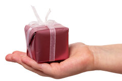 Child holding a gift Stock Images