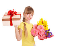 Child holding gift box and flowers. Royalty Free Stock Photography