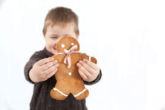Child holding Gingerbread man Royalty Free Stock Photos