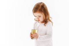 Child holding glass of dirty water royalty free stock image
