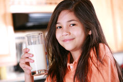 Child holding glass of milk Stock Photos