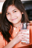 Child holding glass of milk Royalty Free Stock Photo