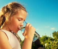 Child holding glass with water Stock Photos