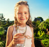 Child holding glass water Royalty Free Stock Photo