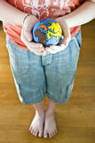 Child holding a Globe. Globe on child hands, close-up stock photos