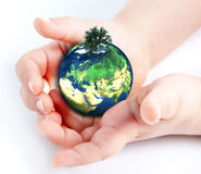 Child holding globe in hands. Child holding green globe in hands Royalty Free Stock Image
