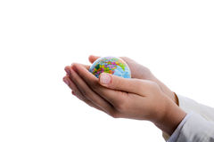 Child holding a globe. Child holding a small globe in hand on white background Stock Photos