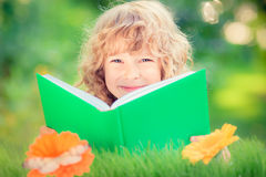 Child holding green book Stock Photography