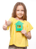 Child holding a green house Stock Photography