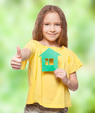 Child holding a green house Stock Photo