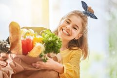Child holding grocery shopping bag Royalty Free Stock Photo