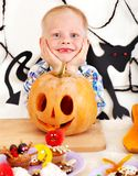 Child holding Halloween pumpkin carving . Royalty Free Stock Image