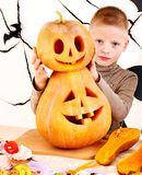 Child holding Halloween pumpkin carving . Stock Photo