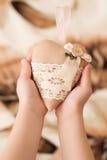 Child holding a handmade heart. Stock Image