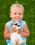 Child holding on hands of a small rabbit Stock Photo
