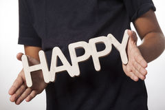 Child holding happy text Stock Images