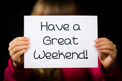 Child holding Have a Great Weekend sign Royalty Free Stock Photo
