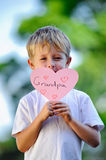 Child holding heart Royalty Free Stock Photography