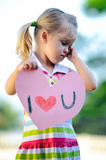 Child holding heart Stock Images