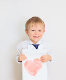 Child holding heart Royalty Free Stock Photos
