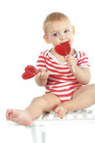 Child holding heart shaped candy Stock Photos