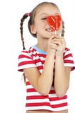 Child holding heart shaped candy Royalty Free Stock Photos