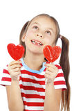 Child holding heart shaped candy Stock Image