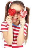 Child holding heart shaped candy Royalty Free Stock Photo