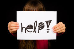 Child holding Help sign Stock Image
